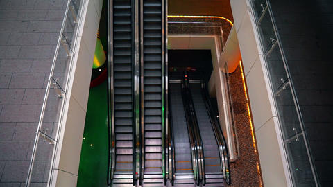 Center's escalators are working. Top view of architecture, urban transportation Footage