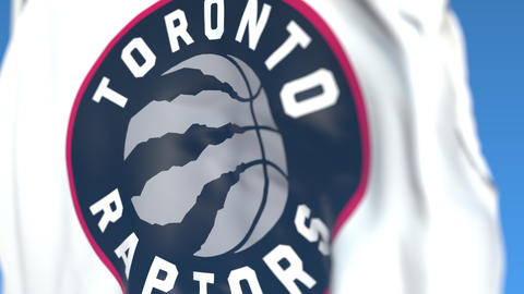 Flying flag with Toronto Raptors team logo, close-up. Editorial loopable 3D Live Action
