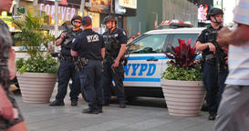 Armed New York Police Officers Monitor Times Square Footage