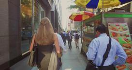 People Walk on the Busy Sidewalks of Manhattan Footage