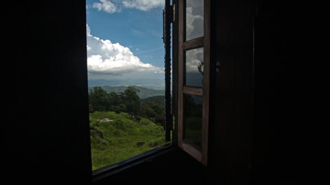 Camera Moves away from Landscape through Window to Room Footage