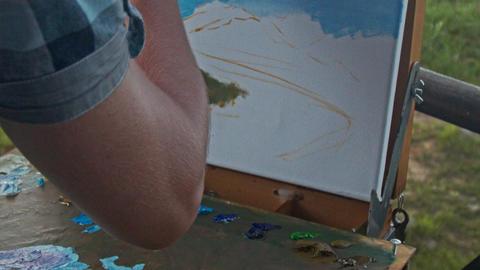 Closeup Painter Hand Paints Landscape Picture in Oils Footage