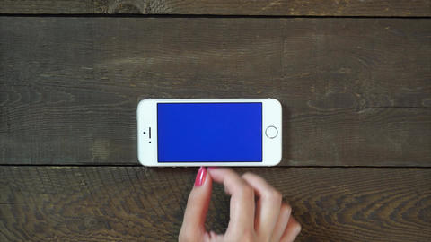 Zoom In Hand Smartphone with Blue Screen Footage