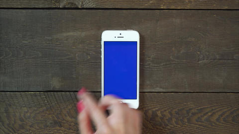 Swipes Left Hand Smartphone with Blue Screen Footage