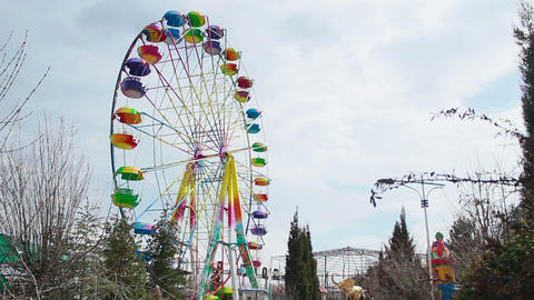 Colored ferris wheel on a cloudy day Footage