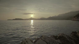 Seascape at sunset. The sea water in sunset light. The mountains and the sea Live Action