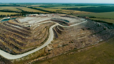 Special Equipment Works At A Garbage Dump. Huge Garbage Dump view from drone Live Action