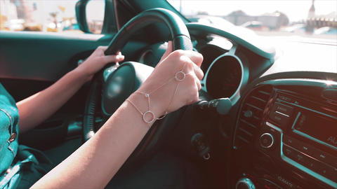 Woman driving car, steering with hand. Travel, transportation concept. Female hand on road sunny day Live Action