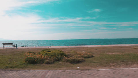 Beautiful beach and sea trip, on coastline. Shot from car, speed journey and transportation Live Action
