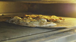Authentic Italian pizza baking in oven Live Action