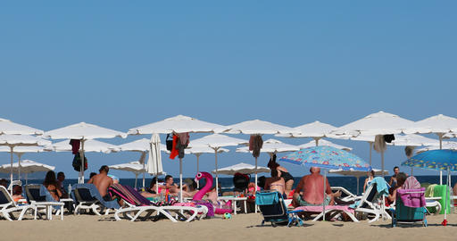 Many Sun Parasols On White Sandy Beach Live Action