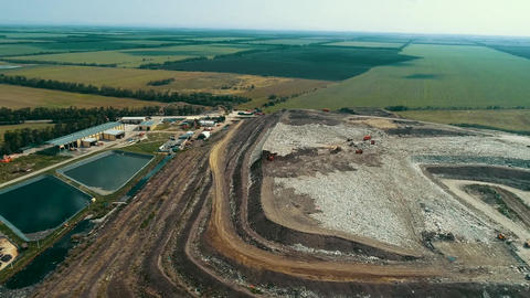 Toxic lakes at the landfill. Top view of the garbage dump. panoramic view of the Footage