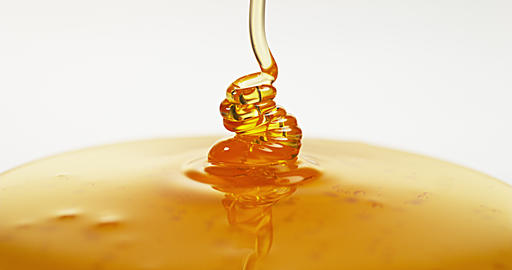 Honey Flowing against White Background, Slow Motion 4K Live Action