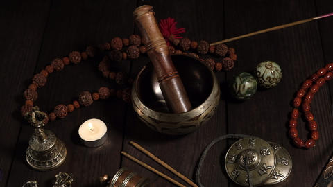 singing bowl, prayer beads, prayer drum, stone balls and other Tibetan religious objects for Footage