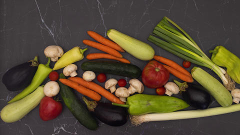Stop motion animation of fresh and organic vegetables appearing on kitchen table Animation