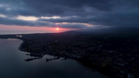 Sunset on the sea shore cityscape sunset on the horizon. Sukhumi, Abkhazia Live Action