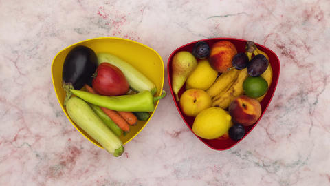 Stop motion animation of two dishes filling with fruits and vegetables Animation