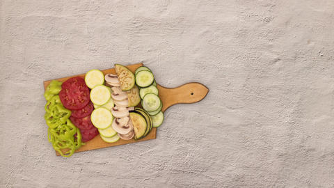 Stop motion animation of cutting vegetables on cutting board Animation