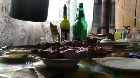 Lunch at the table, barbecue, boiled potatoes, the beer is poured from a plastic Footage