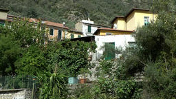 Europe Italy Liguria Airole village 008 typical houses with gardens at hillside Footage