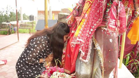 Girl worshipping hindu goddess Footage