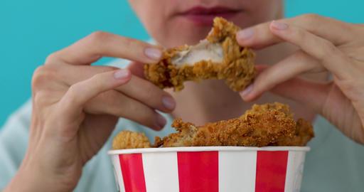 Girl eating chicken wings Footage