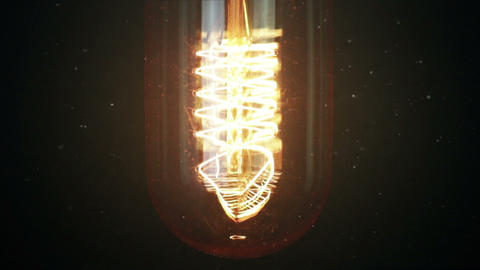 turn on and turn off, close-up of retro vintage light bulb with tungsten technology built-in on Live Action
