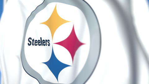 Waving flag with Pittsburgh Steelers team logo, close-up. Editorial 3D rendering Photo