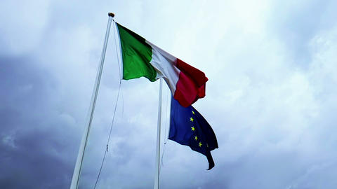 waving fabric texture of the flag of italy and union europe on blue sky with Live Action