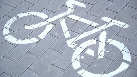 Riding bicycle, crossing cycle path sign, bike friendly city, urban scene Footage