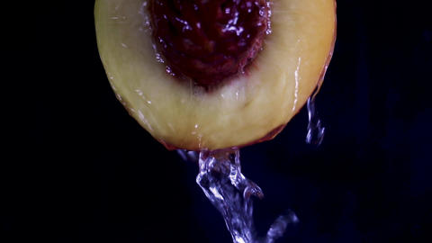 Close up water dropping on slice of pear on black background. Fruit, diet and healthy life Live Action