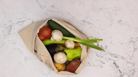 Stop motion animation woman's hand taking fresh vegetables from shopping bag Animation