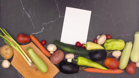 Stop motion animation of fresh and organic vegetables appearing on kitchen table with cutting board Animation