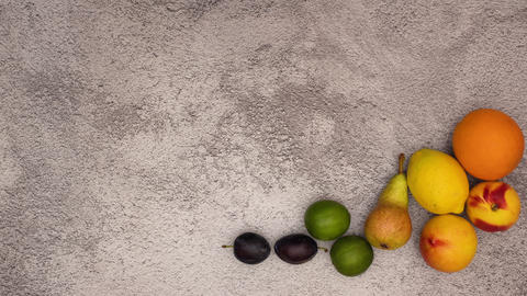 Stop motion animation of fresh and organic fruits. Dance of fresh fruits moving around Animation