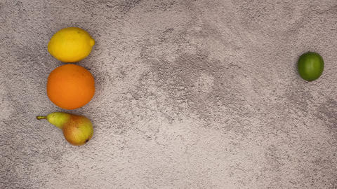 Stop motion animation of fresh and organic fruits appearing on grey background Animation