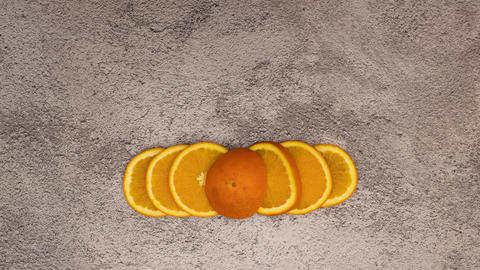 Stop motion animation of Fresh and organic orange appear on background and split up on slices Animation