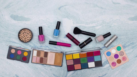 Stop motion animation of make up and cosmetics products appear on the table Animation