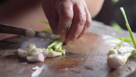 Spring onion get slicing by knife in lady hands.... Stock Video Footage