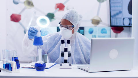 Female scientist in coverall equipment working in chemistry laboratory Footage