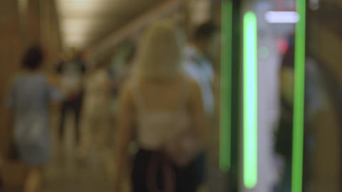Blurry people entering the subway train Footage