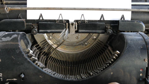 Man printing text with the typewriter, closeup view Footage
