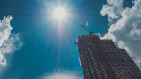 Corporate Buildings Under Construction, Blue Sky, Sun and Clouds Footage