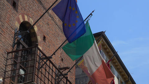 Italian and European Flag attached to a house Footage