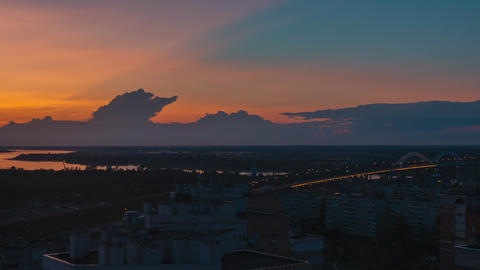 Clouds floating in sunset sky aerial view from drone. Timelapse colorful evening sky over modern Live Action