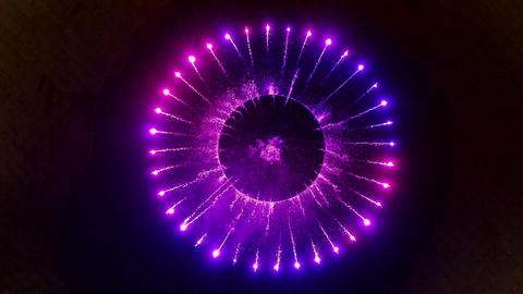 Top view colorful musical fountain in dark. Flowing water on illuminated fountain in dark city. Live Action