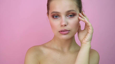Beautiful girl at studio background, beauty concept, at pink background Live Action