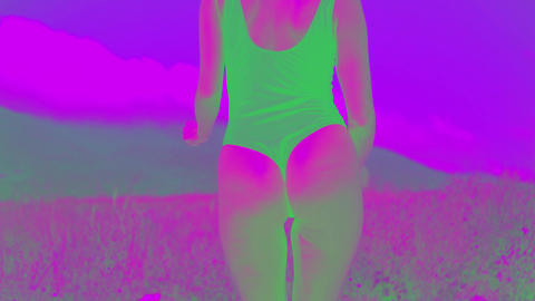A hot woman in a swimsuit is dancing with change color effect, effect disco Live Action