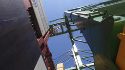 container ship being unloaded by crane ship to truck 4k Footage