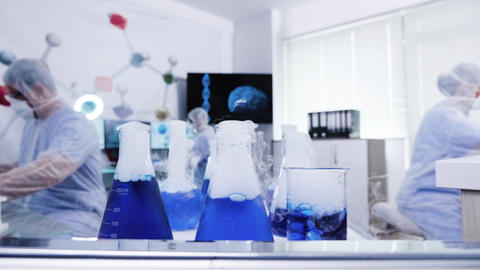 Smoking blue liquid on cart in a modern science laboratory Footage