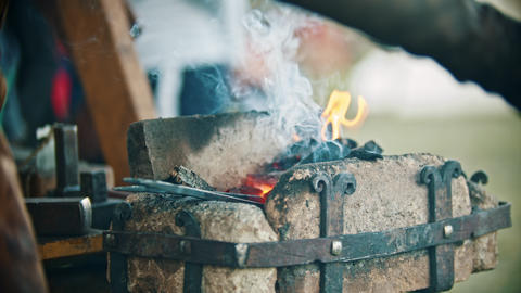 Blacksmith working with an iron details in his workshop -... Stock Video Footage